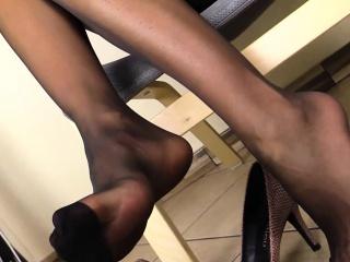 sexy ethnic babe runs her hands through nylon stockings