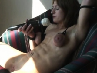 horny brunette with tied tits plays with vibrator