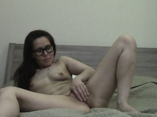 nerdy woman masturbates in front of the webcam