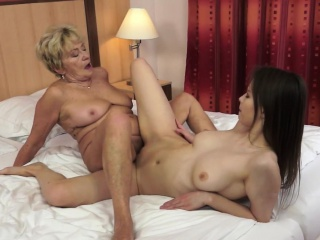 mature lez scissoring with a busty beauty