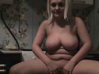 busty blonde really enjoys fingering her pussy