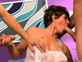 mature lady takes on two studs