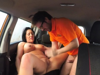 busty tanned babe fucks in driving school car