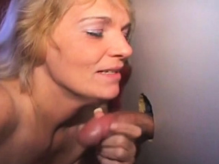 wild blonde amateur sucking dick through a glory hole