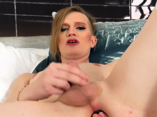 lingeried tgirl rides toy while tugging solo