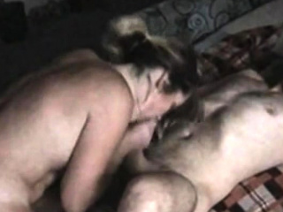 russian brunette gags on a big cock