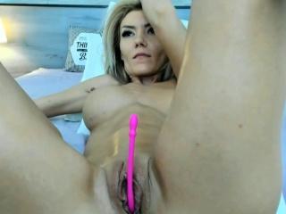 blonde babe with fake big tits masturbates her pussy