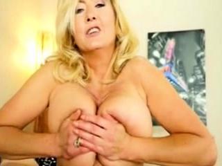 blonde slut with massive boobs gives titjob in pov