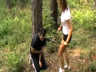 girls kicks slaves outdoor