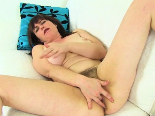 british milf tammy gets aroused in fishnets and jeans
