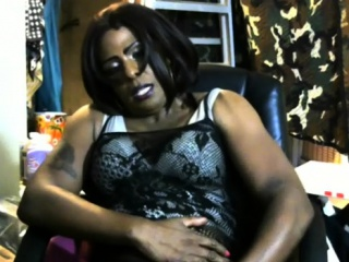 sexy ebony shemale in a black lingerie plays with her cock