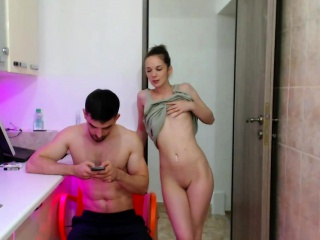 young couple posing in the kitchen on webcam