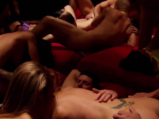 swinger couples strip down as they fool around