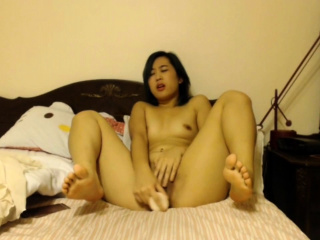 chubby asian chick masturbates with a dildo