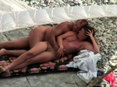 Public outdoor sex on the beach by private couple