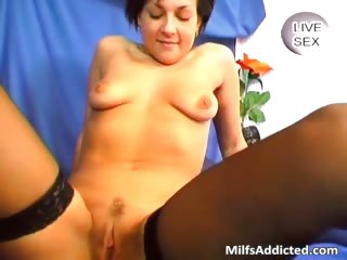 brunette milf in sexy lingerie teases
