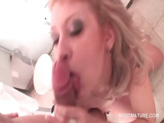 dick addict mature blonde giving blowjob on knees in bath